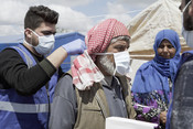 Islamic Relief provide masks, shelter and food items to families in Al-Harakat Camp