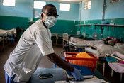 Abdi Ali, a nurse at Keysaney hospital wears a mask as he attends patients.