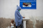 Women queue to wash their hands at a health clinic in the Bondhere district of Mogadishu