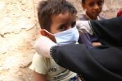Child wearing a mask in Yemen