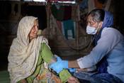 83 years old Ayesha sitting inside her shelter