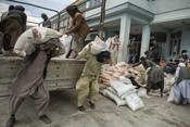 Shir Mohammad (38), volunteers to help unload food packages