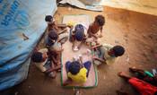 Children play cards in an IDP Camp in Yemen