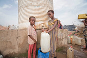 Cousins Hadia*, 7, (left) and Gamila*, 11, (right) collecting water from an IDP Camp in Yemen