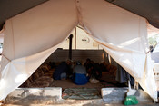 Mohammed Mardabsawis family eats lunch in their tent in Zaitoun Maarshurin refugee camp