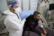 Bassam Abdel Moneim, a patient infected with COVID-19, receives medical care