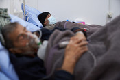 Haroon Al-Sagheer, a patient infected with COVID-19, receives medical care